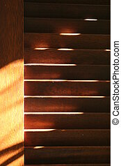 Dusty Wood Shutter - Brown shutters with dust in evening...