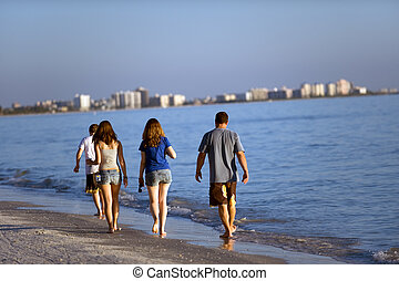 Fort Meyers beach - Young people strolling along Florida...