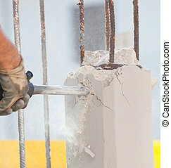 Breaking reinforced concrete with jackhammer