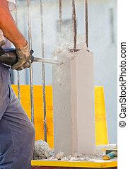 Breaking reinforced concrete with jackhammer - Workers break...