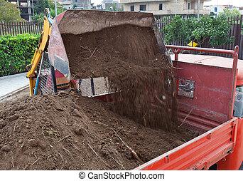Excavator loading dumper truck tipper - Excavator loading...