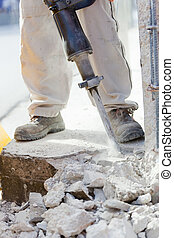 Breaking reinforced concrete with jackhammer - Workers break...