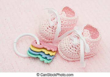 Baby Booties - Baby booties with key rattle on a pink...