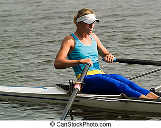Rowing girl - Sporty young lady rowing in boat on water
