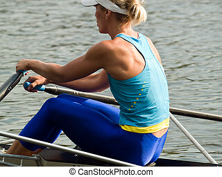 Rowing girl - Sporty young lady rowing in boat on water rear...