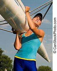 Girl holding boat