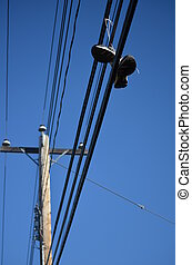 Shoes on power lines - shoes hanging from powerlines