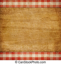 Cutting board over red grunge checked gingham picnic...