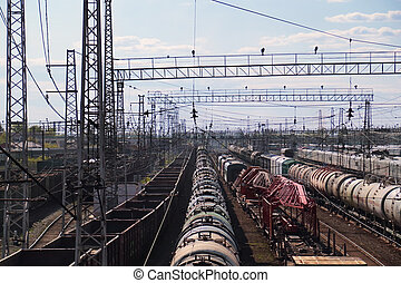 Long freight trains at railway station with many railroads