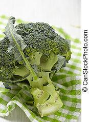 Fresh raw broccoli on wooden board
