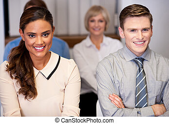 Happy business people attending meeting - Businessmen and...