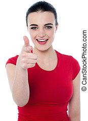 Young woman pointing her finger to you - Happy young casual...