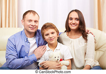 Family at leisure - Portrait of happy family of three...