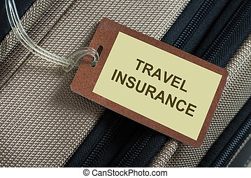 Travel insurance tag tied to a luggage