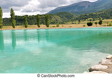 turqouise water lake ((Dr?me, France) - turquoise water lake...