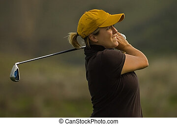 Collegiate golfer swing golf club - Female collegiate golfer...