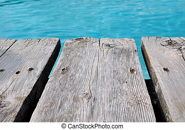 wooden floor - crude wooden floor of a pontoon at the edge...