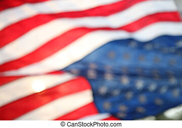 Backlit American flag blurred - The flag of the United...