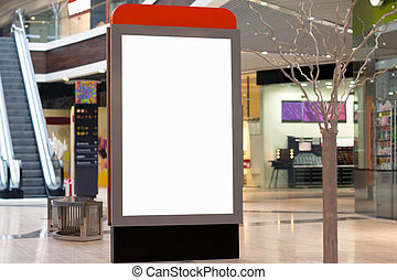 Citilayts with blank screen stands in a megastore -...