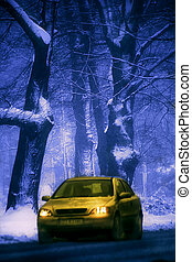 yellow car in wintry forest - Yellow car on the road in the...