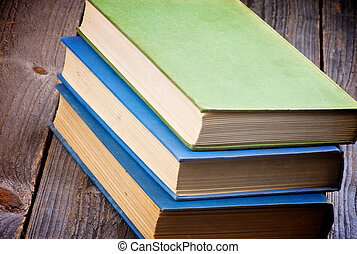 Old Books - Pile of Three Old Books isolated on Rustic...