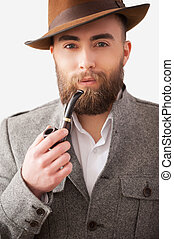 Man with a smoking pipe. Portrait of handsome young man in...