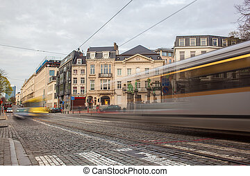 Tramway in motion on the street of Brussels near The Sablon...