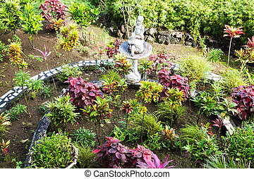 Cement Bird Bath in Public Garden - A formal public garden...