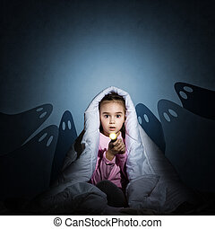 girl under the covers with a flashlight - image of a girl...
