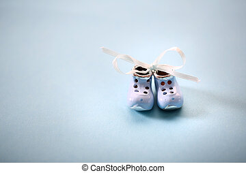 small silver shoes - Tiny porcelain shoes on the background...