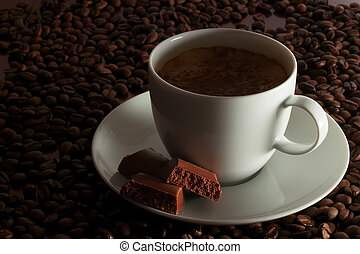 cup of coffee with pieces of air chocolate