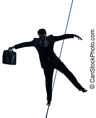 Businessman tightrope walker silhouette - one caucasian...