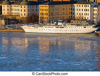 Stockholm Riddarholmen in winter. - Old white ship at...