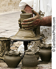 Potter at Work - Detail of a pottery maker hands at work on...