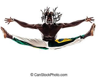 brazilian black man dancer dancing capoeira silhouette - one...