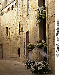 Mdina Flowers - A medieval street with flower arrangement...