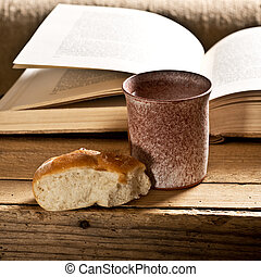 Bible With Chalice - still life with Bible chalice and bread