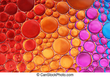 Oil and water over colors 18 - Oil drop and water over red,...