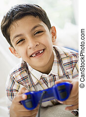A Middle Eastern boy playing a video game