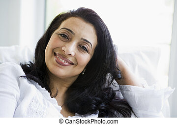 A Middle Eastern woman sitting at home
