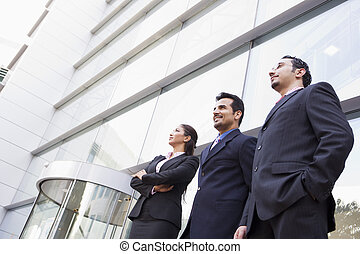 Group of business people outside office - Group of business...
