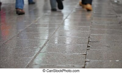 People walking on wet pavement - Winter and snow people...