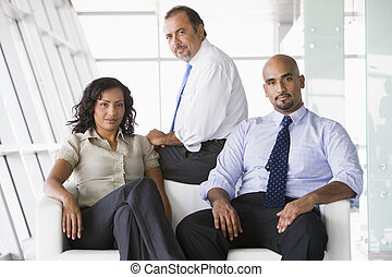 Group of businesspeople in lobby - Group of businesspeople...