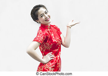 Asian Chinese woman in Traditional Chinese Cheongsam...