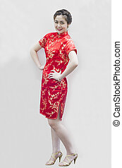 smiling beautiful chinese young woman gesturing with...