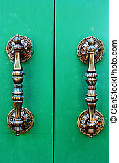 brass handle with emerald door