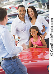 Young family collecting new car