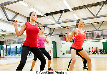 group of people working out with barbells - fitness, sport,...