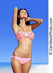 beautiful woman sunbathing on beach