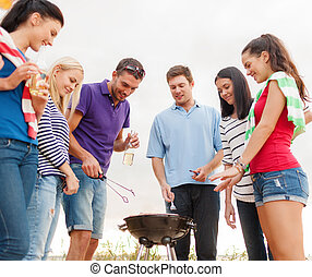 group of friends making barbecue on the beach - summer,...